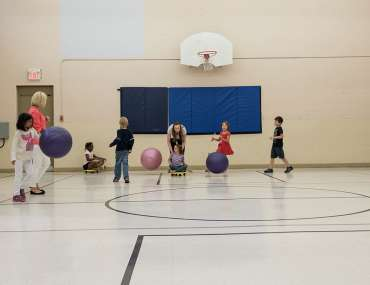 Kids playing with balls in the gym