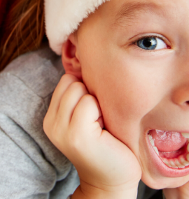 children laughing wearing santa hats